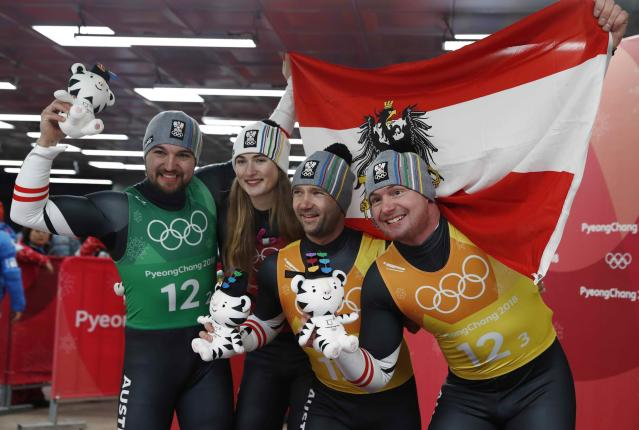 Luge - Pyeongchang 2018 Winter Olympic Games - Team Relay - Pyeongchang, South Korea - February 15, 2018 - Bronze medalists Madeleine Egle, David Gleirscher, Peter Penz and Georg Fischler of Austria during the victory ceremony. REUTERS/Edgar Su