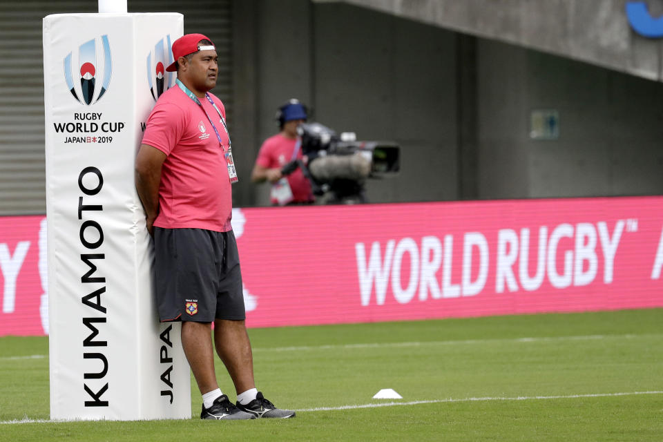 FILE - In this Sept. 28, 2019, file photo, Tonga's coach Toutai Kefu watches his players warm up ahead of the Rugby World Cup Pool C game at Hanazono Rugby Stadium between Tonga and Argentina in Osaka, western Japan. Kefu has been seriously injured and three other members of his family received knife wounds during an alleged break-in at his home in Brisbane's south Monday, Aug. 16, 2021. (AP Photo/Aaron Favila, File)