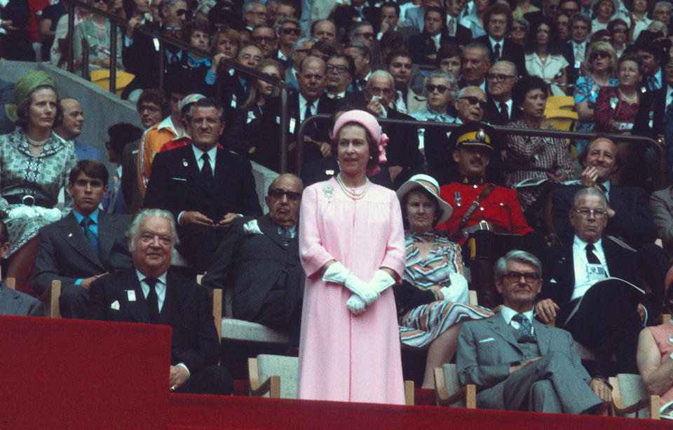 Queen Elizabeth ll, Prince Andrew (left) and Lord Killanin attend the opening ceremony of the 1976 Montreal Summer Olympics on July 17, 1976 in Montreal, Canada. (Credit: Anwar Hussein/Getty Images)