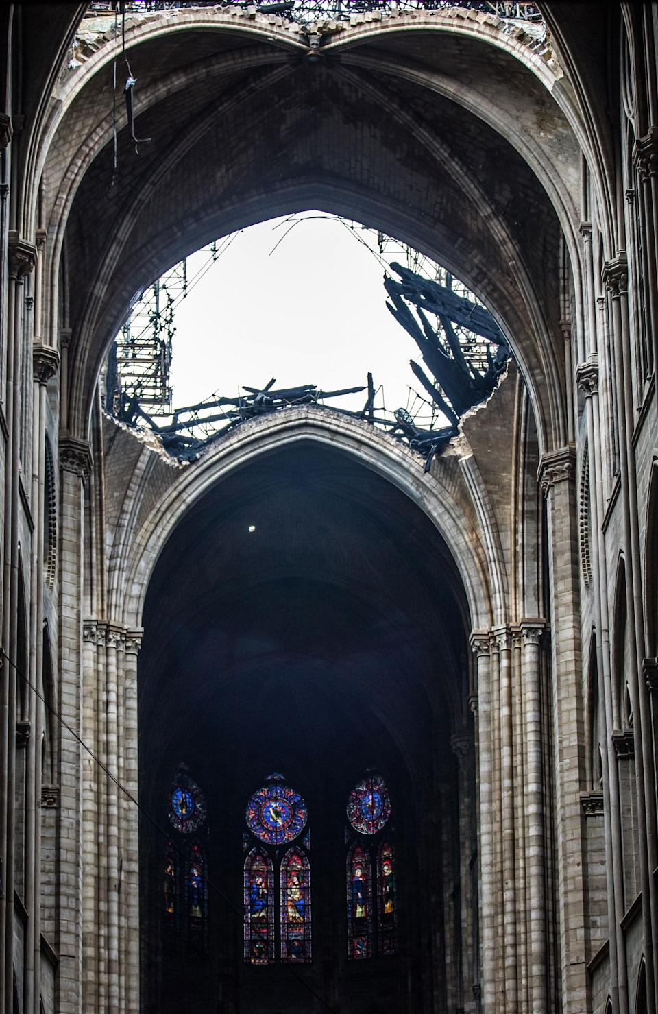 This general view shows the damaged roof of the Notre-Dame-de Paris Cathedral in Paris on April 16, 2019, a day after a fire that devastated the building in the centre of the French capital. - Pledges from French billionaires, businesses and the public sector to help rebuild Notre-Dame cathedral have reached nearly 700 million euros (790 million dollars) amid an outpouring of public support for one of Europe's most iconic monuments. (Photo by Christophe PETIT TESSON / POOL / AFP)        (Photo credit should read CHRISTOPHE PETIT TESSON/AFP/Getty Images)