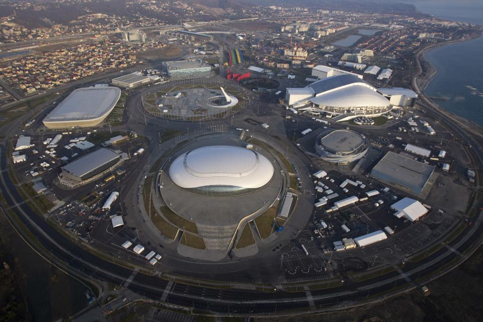 "An aerial view from a helicopter shows the Olympic Park under construction in the Adler district of the Black Sea resort city of Sochi, December 23, 2013. Sochi will host the 2014 Winter Olympic Games in February. The view shows (clockwise from R, top) the ""Fisht"" Olympic Stadium, the ""Shayba"" Arena, the ""Bolshoy"" Ice Dome, the ""Ice Cube"" Curling center, the ""Adler Arena"" and the ""Iceberg"" Skating Palace. Picture taken December 23, 2013. REUTERS/Maxim Shemetov (RUSSIA - Tags: CITYSCAPE BUSINESS CONSTRUCTION SPORT OLYMPICS)"