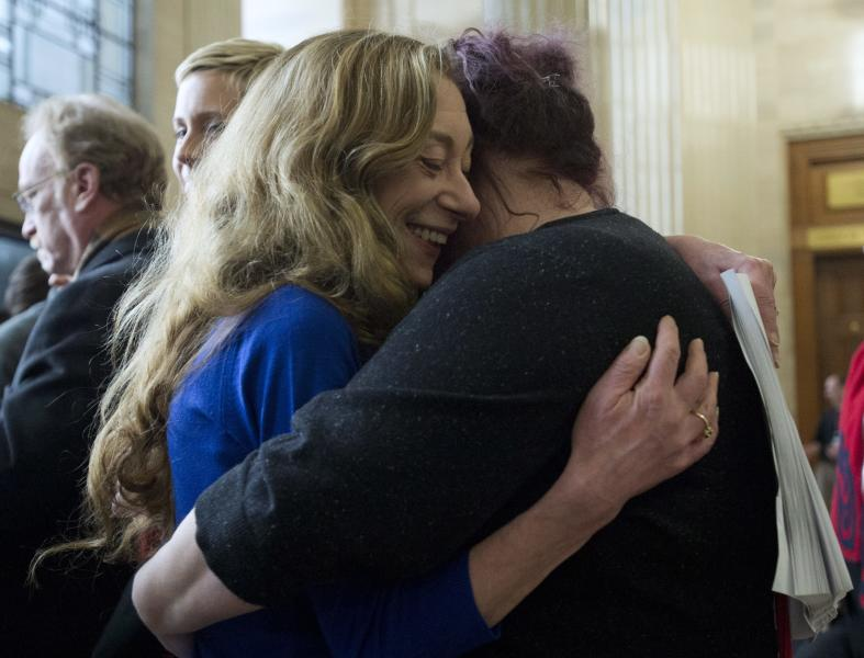 Valerie Scott and Amy Lebovitch embrace at the Supreme Court of Canada in Ottawa Friday morning, Dec. 20, 2013 after learning Canada's highest court struck down the country's prostitution laws in their entirety in a unanimous 9-0 ruling. Scott, a former prostitute, and Lebovitch, a sex worker, are two of the three principals in the case. (AP Photo/The Canadian Press, Adrian Wyld)