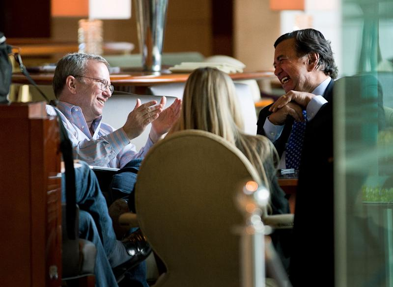 Google's executive chairman Eric Schmidt, right, chats with former New Mexico Gov. Bill Richardson, right, during their meeting at a hotel in Beijing Monday, Jan. 7, 2013. Schmidt, who is part of a delegation led by Richardson, is scheduled to leave Monday on a commercial flight bound for North Korea, a country considered to have the world's most restrictive Internet policies. (AP Photo/Andy Wong)