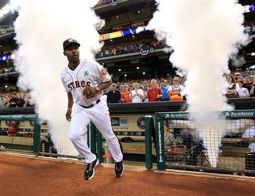 Houston Astros manager Bo Porter (16) runs out during player introductions before a season-opening baseball game against the Texas Rangers at Minute Maid Park, Sunday, March 31, 2013, in Houston. (AP Photo/Houston Chronicle, Karen Warren)