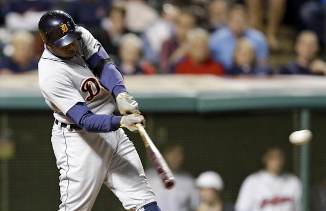 Detroit Tigers' Rajai Davis hits a two-RBI double off Cleveland Indians starting pitcher Corey Kluber in the seventh inning of a baseball game, Monday, May 19, 2014, in Cleveland. Nick Castellanos and Alex Avila scored. (AP Photo/Tony Dejak)