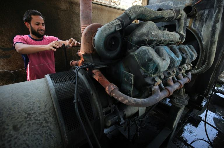 A man in Baghdad checks a electricity generator in this file photo taken on September 13, 2017