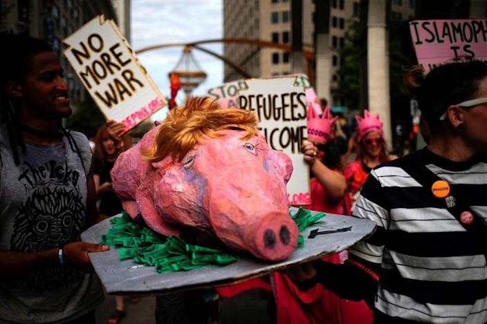 """<p>Activists carry a prop during a protest march by various groups, including """"Black Lives Matter"""" and """"Shut Down Trump and the RNC,"""" ahead of the Republican National Convention in Cleveland on July 17, 2016. (Photo: Adrees Latif/Reuters)</p>"""