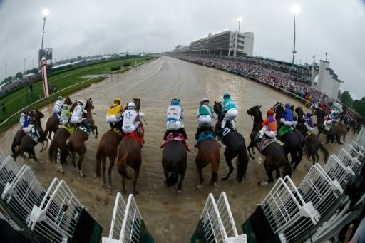 Despite a muddy track that absorbed a Derby-day record three inches of rain and intense downpours as horses were loaded into the starting gates, Justify broke well, starting seventh from the rail