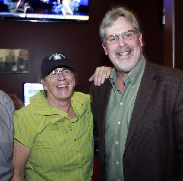 """Captain Richard Phillips, the real-life ship captain being played by Tom Hanks in the docudrama """"Captain Phillips,"""" right, enjoys a laugh with sister-in-law Lea Coggio, before a screening of """"Captain Phillips,"""" on Tuesday, Oct. 1, 2013 in Williston, Vt. The film was adapted from the captain's memoir about the 2009 hijacking of his vessel by Somali pirates. Phillips spent five days as a hostage of the pirates on a lifeboat, where he was beaten, tied up and threatened before he was rescued days later by U.S. Navy SEALs. (AP Photo/Toby Talbot)"""
