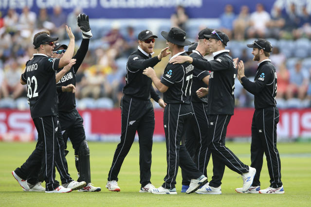 New Zealand's players celebrate after taking the wicket of Sri Lanka's Kusal Perera during the ICC Cricket World Cup group stage match in Cardiff, Wales, Saturday June 1, 2019. (Nigel French/PA via AP)