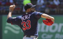 Minnesota Twins starting pitcher Martin Perez delivers against the Texas Rangers in the first inning of a baseball game Sunday, Aug. 18, 2019, in Arlington, Texas. (AP Photo/Richard W. Rodriguez)