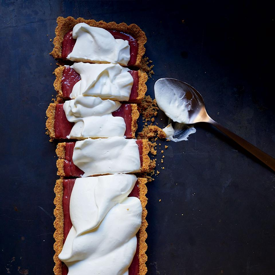 """In this clever riff on lemon pie, <em>Food & Wine</em>'s Laura Rege fills a crunchy graham cracker crust with a sweet and tangy curd made with blackberry vinegar, fresh raspberries and a hint of virgin coconut oil. It's ideal for anyone who enjoys a dessert with some pucker.<strong>Slideshow:</strong> <a rel=""""nofollow"""" href=""""http://www.foodandwine.com/slideshows/pies-and-tarts"""" title=""""Pie and Tart Recipes"""">More Pie and Tart Recipes</a>"""