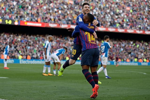 "<a class=""link rapid-noclick-resp"" href=""/soccer/teams/barcelona/"" data-ylk=""slk:Barcelona"">Barcelona</a>'s Lionel Messi, left, celebrates his second goal in Saturday's 2-0 win against <a class=""link rapid-noclick-resp"" href=""/soccer/teams/espanyol/"" data-ylk=""slk:Espanyol"">Espanyol</a>. (AP/Manu Fernandez)"