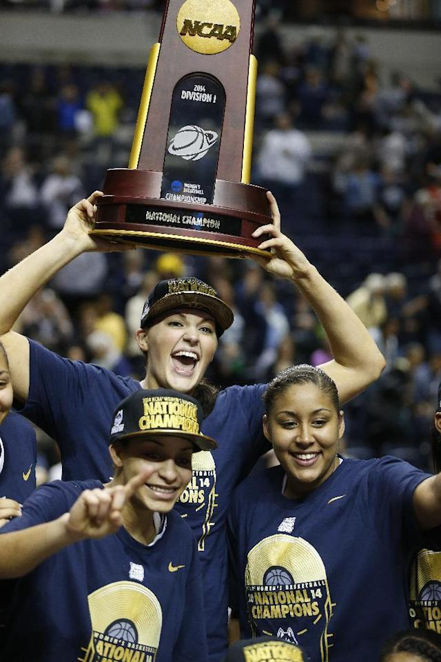 Connecticut center Stefanie Dolson (31) and team members celebrate with the championship trophy after the second half of the championship game against Notre Dame in the Final Four of the NCAA women's college basketball tournament, Tuesday, April 8, 2014, in Nashville, Tenn. Connecticut won 79-58. (AP Photo/John Bazemore)