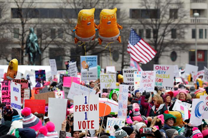 Baby Trump balloons float over thousands of people as they participate in the Third Annual Women's March at Freedom Plaza in Washington, Jan.19, 2019. (Photo: Joshua Roberts/Reuters)