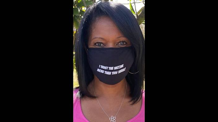 """Dr. Tina Carroll-Scott will be giving out masks that have the words """"I trust the vaccine more than this virus!"""" at her Pfizer pop-up."""