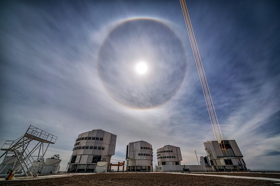 "A lunar ""halo"" glows like an orb in the night sky above the Very Large Telescope in northern Chile, in this photo by European Southern Observatory astronomer Juan Carlos Muñoz-Mateos. This optical phenomenon occurs when moonlight gets refracted by tiny ice crystals and water droplets in the atmosphere."