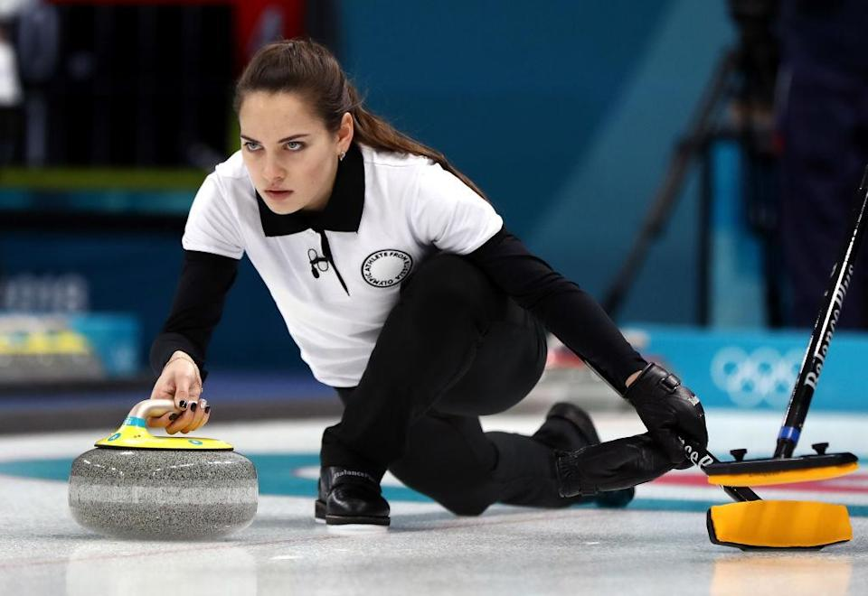 Russia's Anastasia Bryzgalova competes in curling mixed-doubles on the opening day of the Olympics. (Getty)