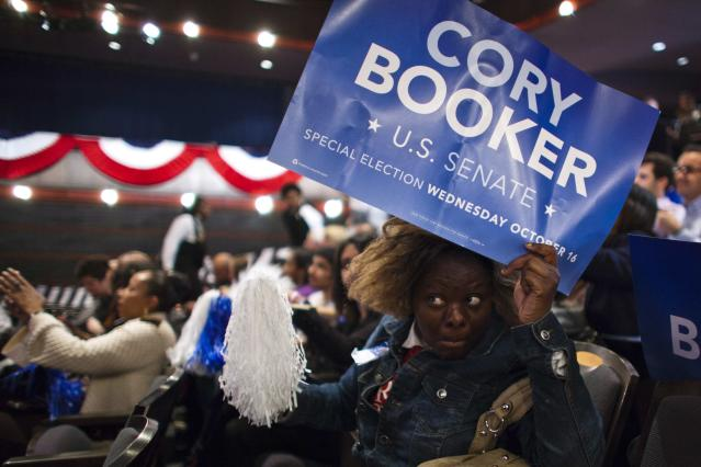 A supporter of U.S. Senate candidate Cory Booker waits for his arrival during his campaign's election night event in Newark, New Jersey, October 16, 2013. Democrat Booker, the charismatic mayor of Newark, was the unofficial winner of a New Jersey special election on Wednesday, handily defeating a conservative Republican to fill the state's vacant U.S. Senate seat. REUTERS/Eduardo Munoz (UNITED STATES - Tags: POLITICS ELECTIONS)