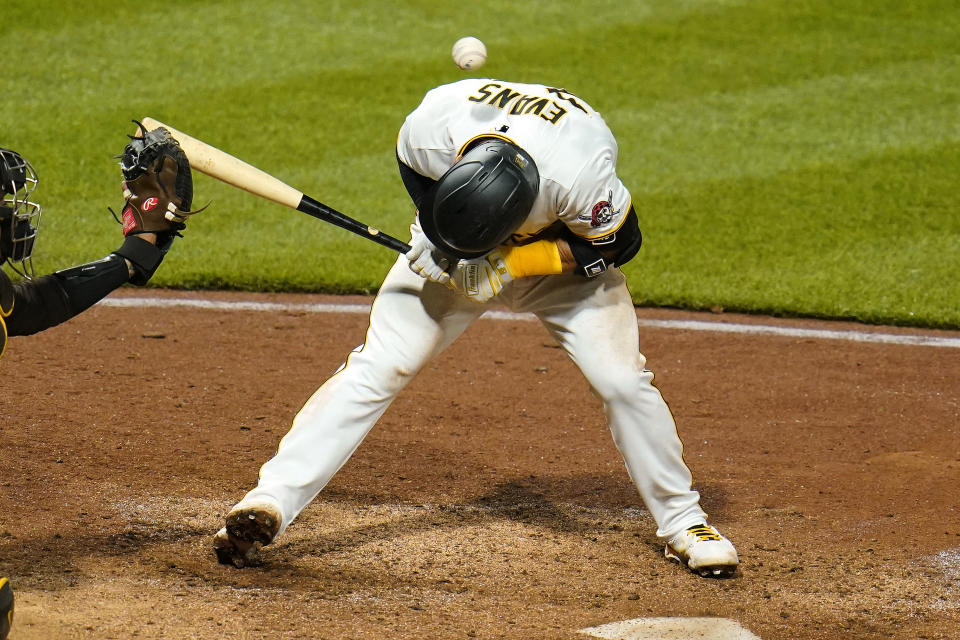 Pittsburgh Pirates' Phillip Evans is hit by a pitch by San Diego Padres relief pitcher Nabil Crismatt during the sixth inning of a baseball game in Pittsburgh, Tuesday, April 13, 2021. (AP Photo/Gene J. Puskar)