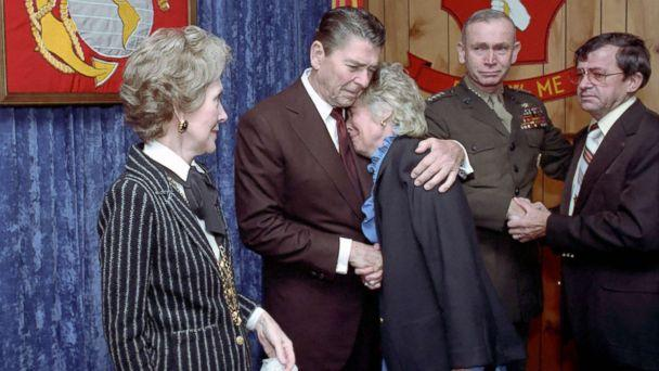 PHOTO: President Reagan consoles a mourner during a memorial service for servicemen killed and wounded in Lebanon and Grenada at the Marine Headquarters Building at Camp Lejeune in North Carolina, Nov. 4, 1983. (Ronald Reagan Presidential Library )