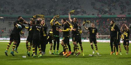 Borussia Dortmund players and staff celebrate after the match