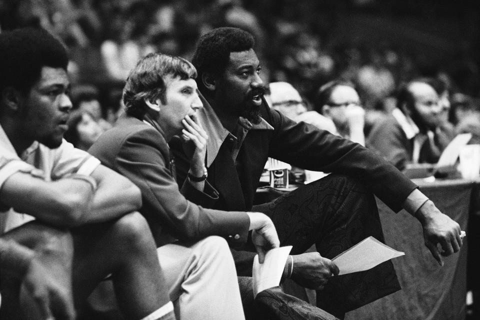 Wilt Chamberlain, right, coach, of the San Diego conquistadors, shares the enthusiasm of assistant coach Stan Albeck in 1979