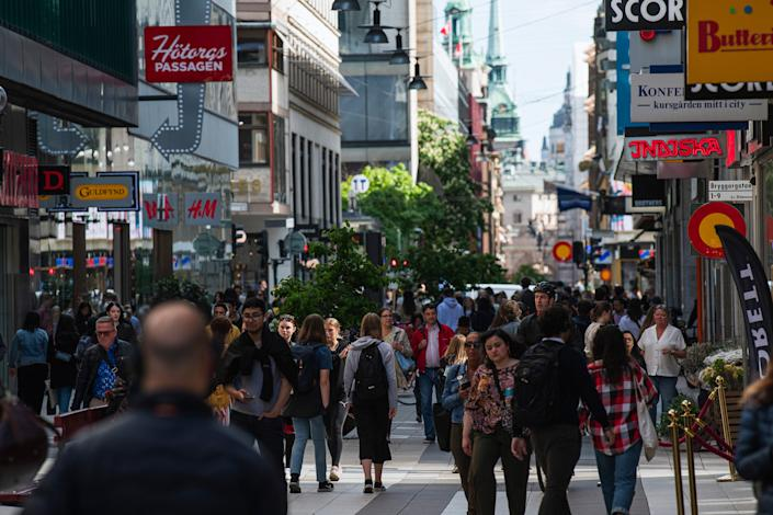 People walk during rush hour in Stockholm on May 29, 2020.