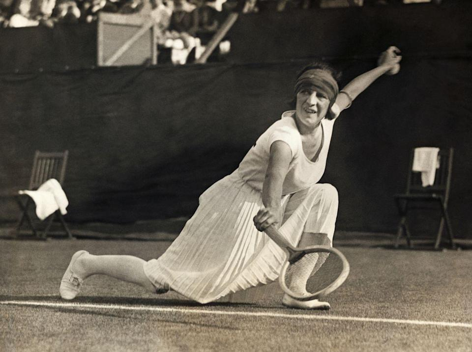 """<p>One of France's top tennis players of the time, Suzanne Lenglen, performs a backhand at the Women's National Lawn Tennis Championship. </p><p>Throughout her tennis career, Lenglen <a href=""""https://www.britannica.com/biography/Suzanne-Lenglen"""" rel=""""nofollow noopener"""" target=""""_blank"""" data-ylk=""""slk:won the Wimbledon competition"""" class=""""link rapid-noclick-resp"""">won the Wimbledon competition</a> in both singles and doubles six times.</p>"""