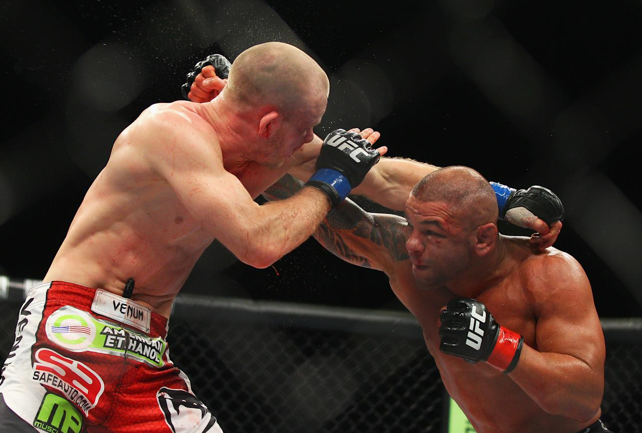 SYDNEY, AUSTRALIA - MARCH 03:  Martin Kampmann of Denmark and Thiago Alves of Brazil exchange blows during the UFC On FX welterweight bout between Martin Kampmann and Thiago Alves at Allphones Arena on March 3, 2012 in Sydney, Australia.  (Photo by Mark Kolbe/Getty Images)