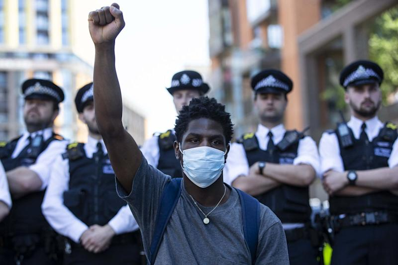 Police were out in force as protesters marched through the city (Getty Images)