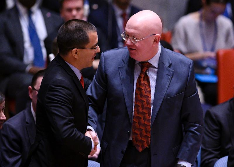 Venezuelan Foreign Minister Jorge Arreaza (L) speaks with Russian Ambassador to the United Nations Vassily Nebenzya at a UN Security Council meeting on Venezuela (AFP Photo/Johannes EISELE)