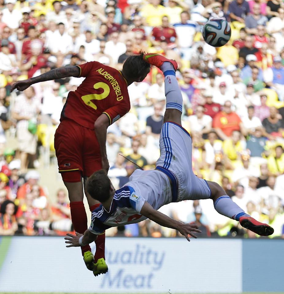Russia's Alexander Kokorin performs a bicycle kick to clear the ball ahead of Belgium's Toby Alderweireld during the group H World Cup soccer match between Belgium and Russia at the Maracana Stadium in Rio de Janeiro, Brazil, Sunday, June 22, 2014. (AP Photo/Natacha Pisarenko)