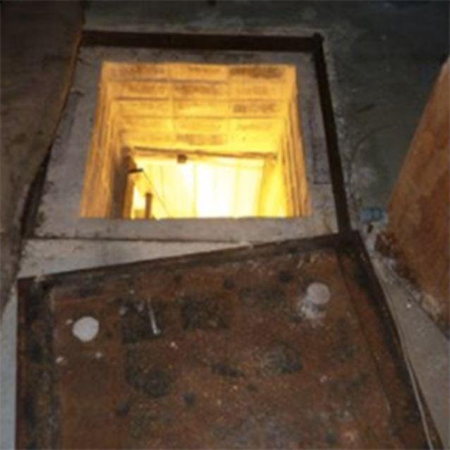 There was a manhole in the ground that lead to the bunker. Photo: SA Police