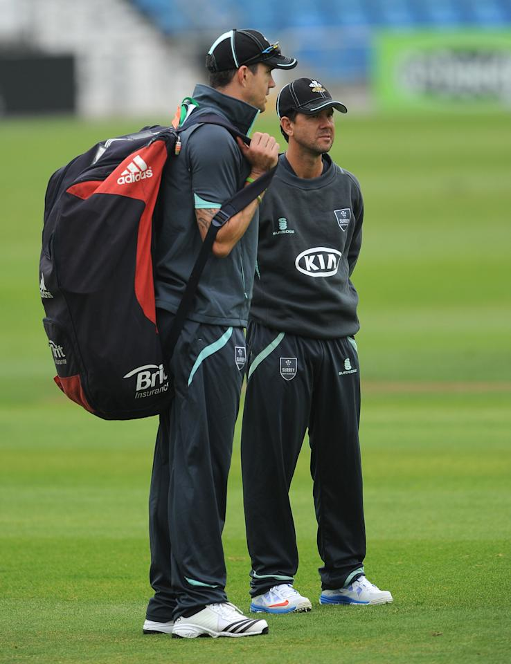 Surrey's Kevin Pietersen (left) talks to Ricky Ponting (right) during day one of the LV County Championship match at Headingley Cricket Ground, Leeds.
