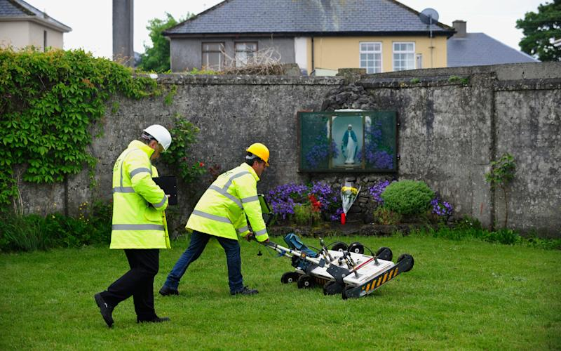 engineers using ground penetrating radar at the site of a mass grave of up to 800 children - Credit: EPA