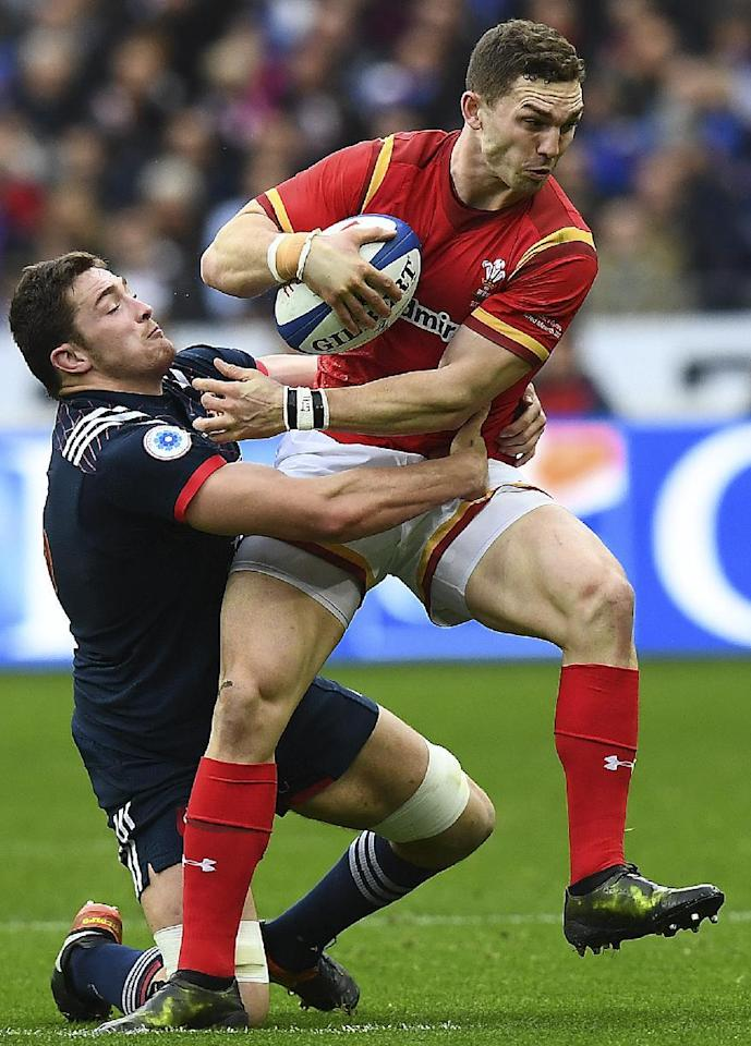 Wales right wing George North is tackled by France flanker Fabien Sanconnie in Paris (AFP Photo/FRANCK FIFE)