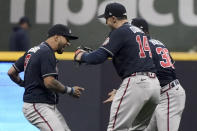 Atlanta Braves left fielder Eddie Rosario, from left, left fielder Adam Duvall and center fielder Guillermo Heredia celebrates their win against the Milwaukee Brewers in Game 2 of baseball's National League Divisional Series Saturday, Oct. 9, 2021, in Milwaukee. (AP Photo/Morry Gash)