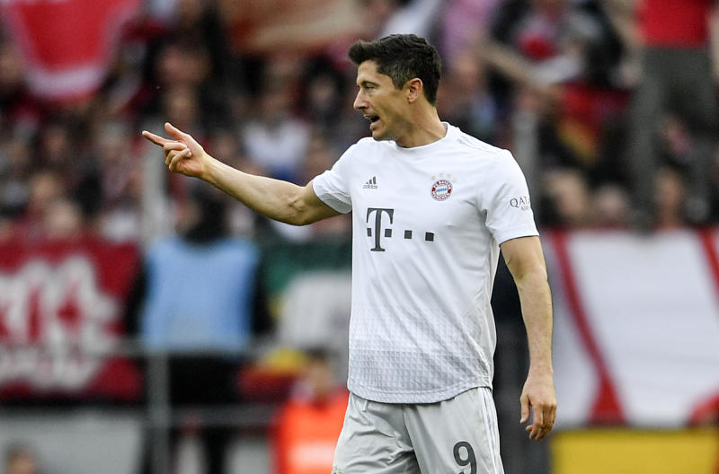 Bayern's Robert Lewandowski reacts after scoring the opening goal during the German Bundesliga soccer match between 1. FC Cologne and Bayern Munich in Cologne, Germany, Sunday, Feb. 16, 2020. (AP Photo/Martin Meissner)