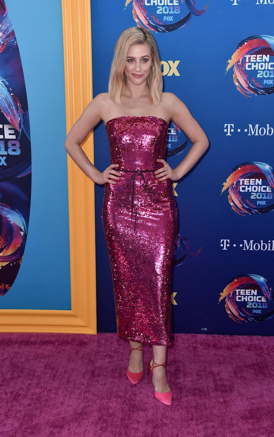 <p>Letting out her infamous 'Riverdale' Betty Cooper ponytail, Lili paired a tousled bob with a sequin Monique Lhullier bodycon dress at the 2018 Teen Awards. <em>[Photo: Getty]</em> </p>