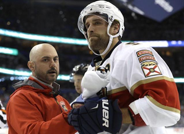 "Florida Panthers defenseman <a class=""link rapid-noclick-resp"" href=""/nhl/players/6367/"" data-ylk=""slk:Aaron Ekblad"">Aaron Ekblad</a> is looked at by a trainer after getting checked into the boards by <a class=""link rapid-noclick-resp"" href=""/nhl/teams/tam/"" data-ylk=""slk:Tampa Bay Lightning"">Tampa Bay Lightning</a> center Gabriel Dumont during the second period of an NHL hockey game, Saturday, March 11, 2017, in Tampa, Fla. (AP Photo/Chris O'Meara)"