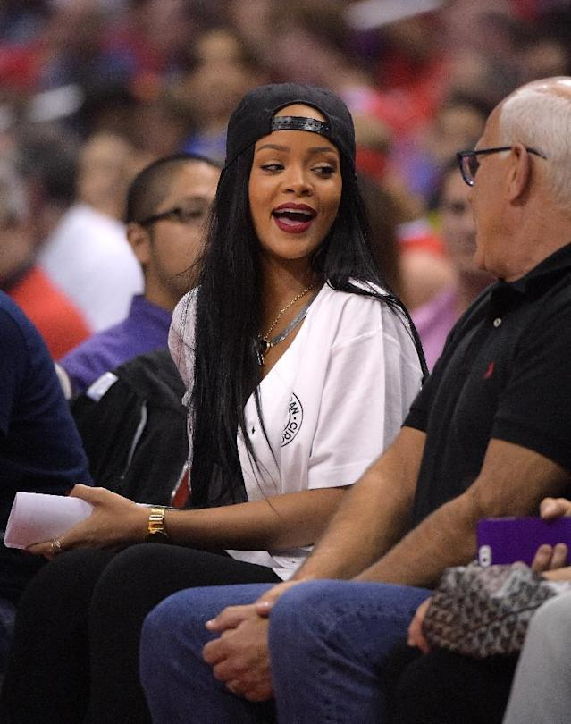 Singer Rihanna attends the Los Angeles Clippers play the Oklahoma City Thunder in the second half of Game 3 of the Western Conference semifinal NBA basketball playoff series, Friday, May 9, 2014, in Los Angeles. The Thunder won 118-112. (AP Photo/Mark J. Terrill)