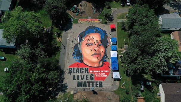 PHOTO: In an aerial view from a drone, a large-scale ground mural depicting Breonna Taylor with the text 'Black Lives Matter' is seen being painted at Chambers Park on July 5, 2020, in Annapolis, Md. (Patrick Smith/Getty Images, FILE)