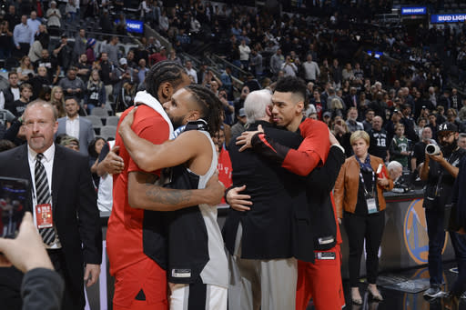 SAN ANTONIO, TX - JANUARY 3: Kawhi Leonard #2 of the Toronto Raptors Patty Mills #8 of the San Antonio Spurs Head Coach Gregg Popovich of the San Antonio Spurs and Danny Green #14 of the Toronto Raptors exchange hugs after the game on January 3, 2019 at the AT&T Center in San Antonio, Texas