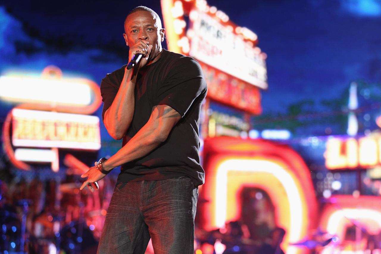INDIO, CA - APRIL 15:  Rapper Dr. Dre performs onstage during day 3 of the 2012 Coachella Valley Music & Arts Festival at the Empire Polo Field on April 15, 2012 in Indio, California.  (Photo by Christopher Polk/Getty Images for Coachella)