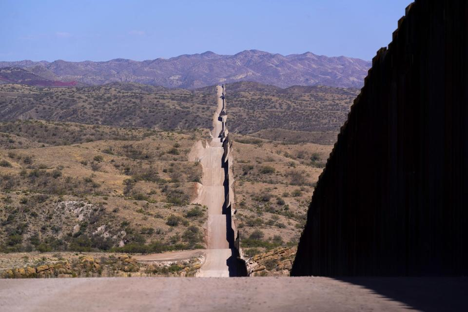 A new border wall stretches along the landscape near Sasabe, Ariz., on Wednesday, May 19, 2021. (AP Photo/Ross D. Franklin)