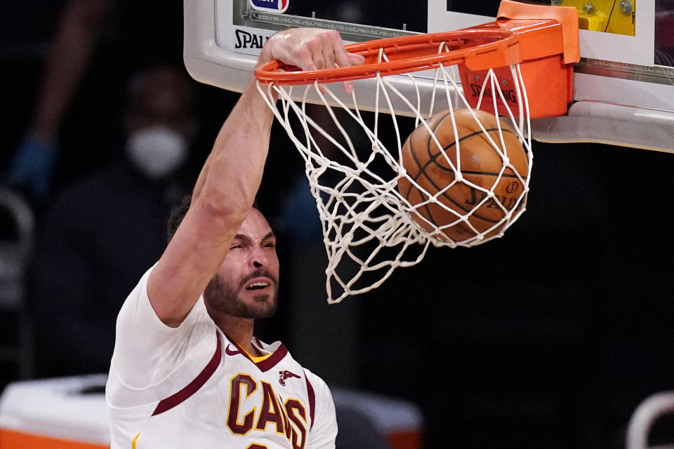 FILE - Cleveland Cavaliers forward Larry Nance Jr. dunks during the first half of an NBA basketball game against the Los Angeles Lakers in Los Angeles, in this Friday, March 26, 2021, file photo. The Cavaliers have agreed to acquire restricted free agent forward Lauri Markkanen from Chicago in a three-way trade that will send forward Larry Nance Jr. from Cleveland to Portland, a person familiar with the deal told the Associated Press on Friday, Aug. 27, 2021. (AP Photo/Mark J. Terrill, File)