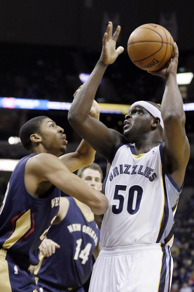 Memphis Grizzlies' Zach Randolph (50) shoots over New Orleans Pelicans' Anthony Davis, left, in the first half of an NBA basketball game in Memphis, Tenn., Wednesday, Nov. 6, 2013. (AP Photo/Danny Johnston)