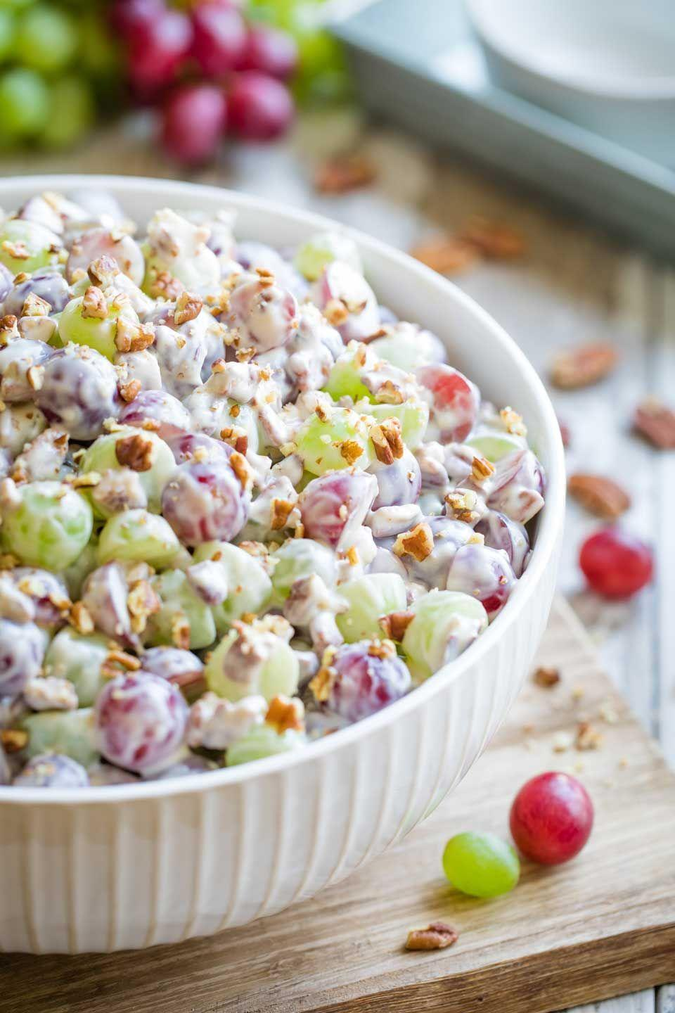 """<p>This classic summertime salad is loaded with refreshing grapes coated in sweet and creamy sauce. To the uninitiated, it may look a bit strange, but we can pretty much guarantee you'll find yourself going back for seconds. </p><p><a href=""""https://twohealthykitchens.com/grape-salad/"""" rel=""""nofollow noopener"""" target=""""_blank"""" data-ylk=""""slk:Get the recipe."""" class=""""link rapid-noclick-resp"""">Get the recipe. </a></p>"""