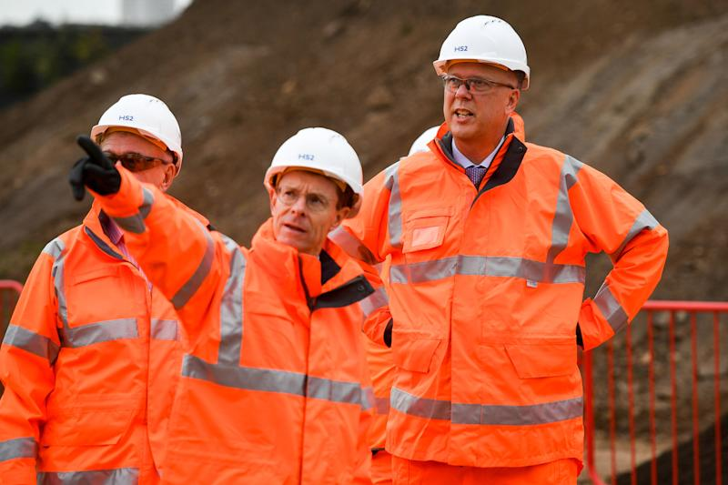 Leader of the House of Commons and Secretary of State for Transport, Chris Grayling (right) meets with construction workers at the Old Curzon Street station site, Birmingham, where work is underway to build the HS2 terminal.